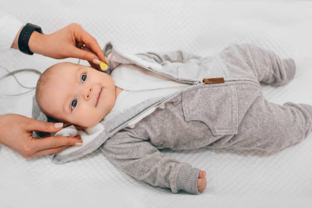 Hearing Test baby , Cortical auditory evoked potential analyzer. hearing screening Hearing Test baby , Cortical auditory evoked potential analyzer. hearing screening auditory cortex stock pictures, royalty-free photos & images