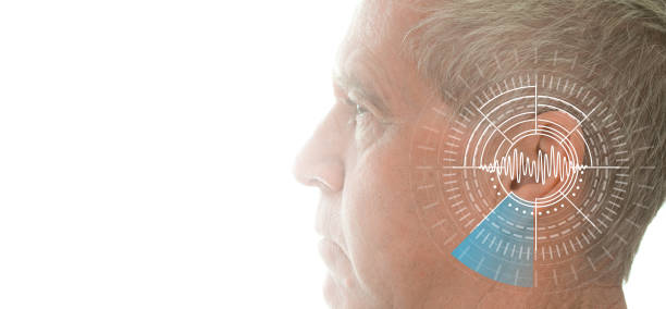 hearing test showing ear of senior man with sound waves simulation technology - ear stock photos and pictures
