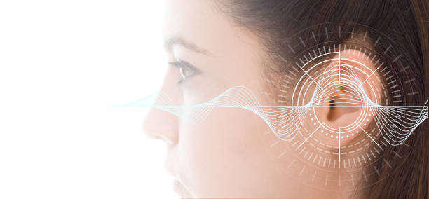 hearing test showing ear of young woman with sound waves simulation technology - ear stock photos and pictures