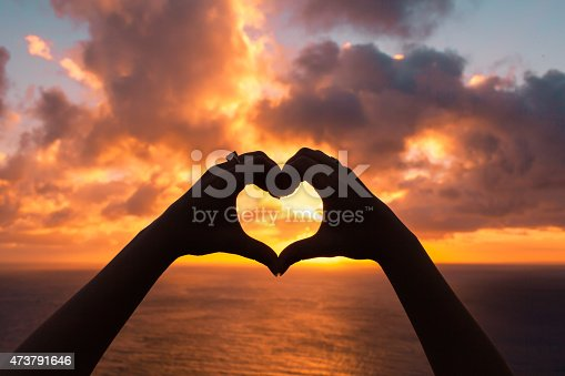 istock Heart against beautiful sunset 473791646
