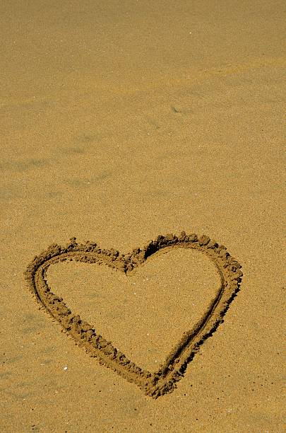Heart Alone In Sand stock photo