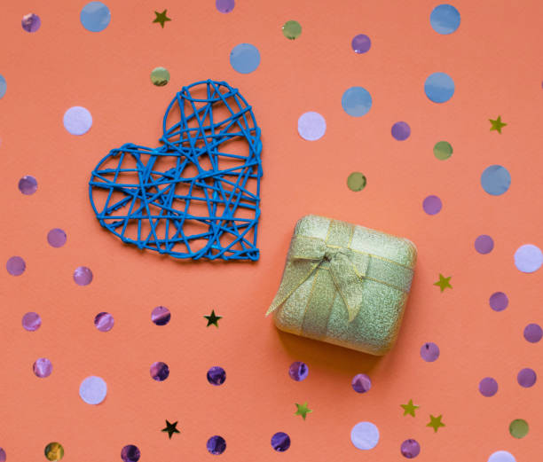 Heart and a gift in a gold box with a bow. stock photo