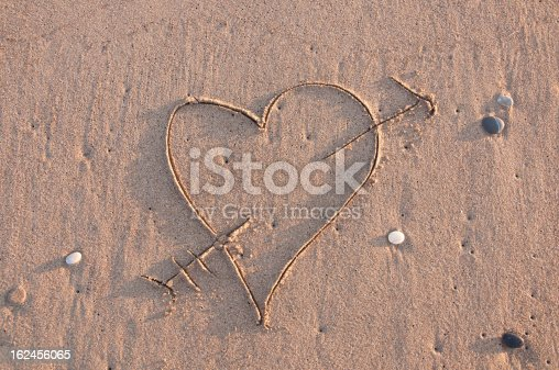 683035640 istock photo Heart and Arrow in Sand 162456065