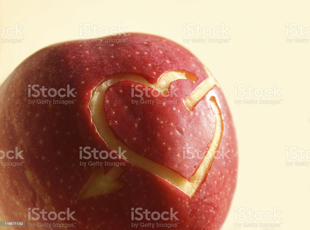Heart and arrow on a red apple royalty-free stock photo