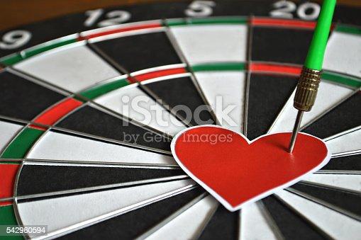 istock Heart and arrow on dart board 542960594