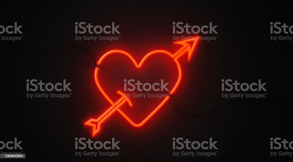 Heart And Arrow Shaped Red Neon Light On Black Wall - Valentines Day And Cupid Concept stock photo