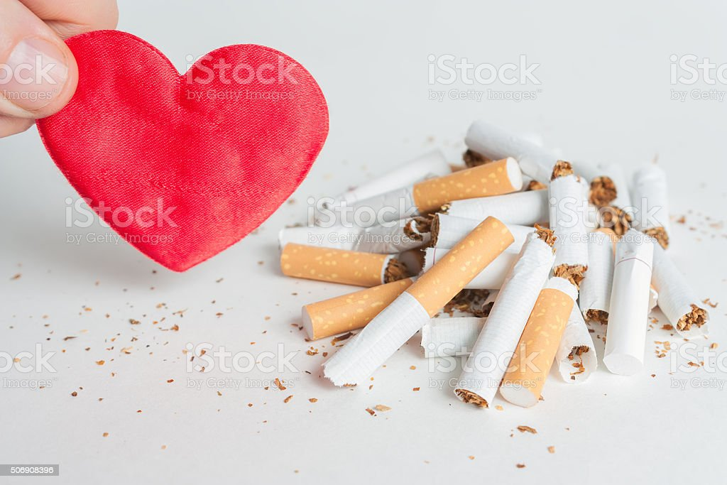 Heart and broken cigarettes. Quit smoking stock photo