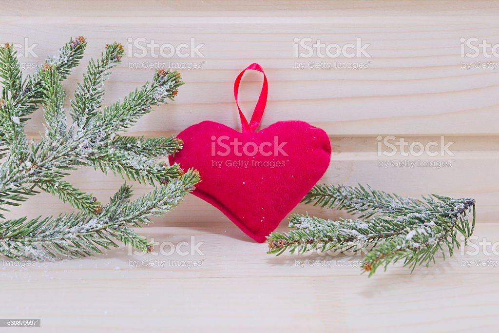 Heart and fir branches on a wooden surface royalty-free stock photo