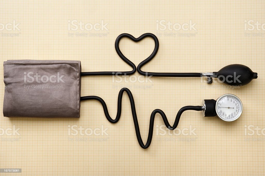 A heart and heartbeat done with a sphygmomanometer stock photo