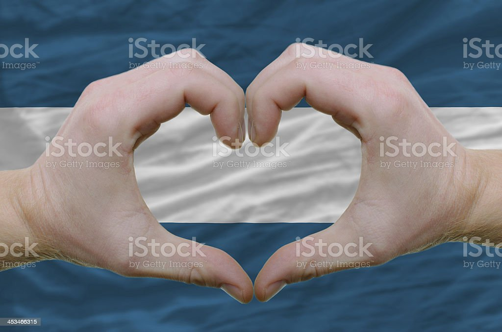 Heart and love gesture over flag of el salvador stock photo