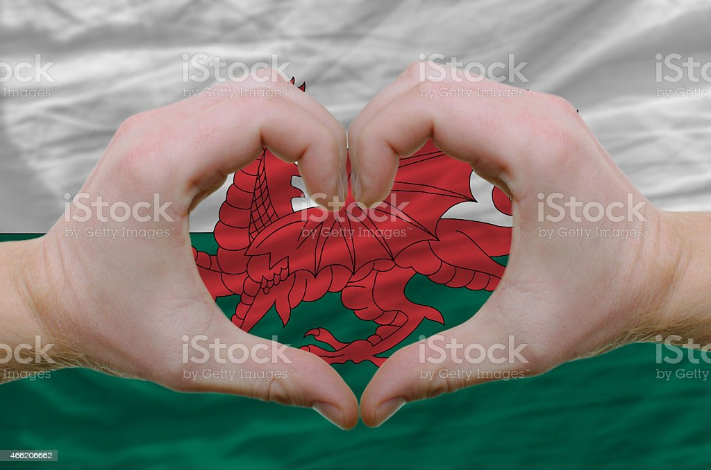 Heart and love gesture over flag of wales stock photo