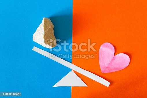 istock Heart and stone on scale 1189120629