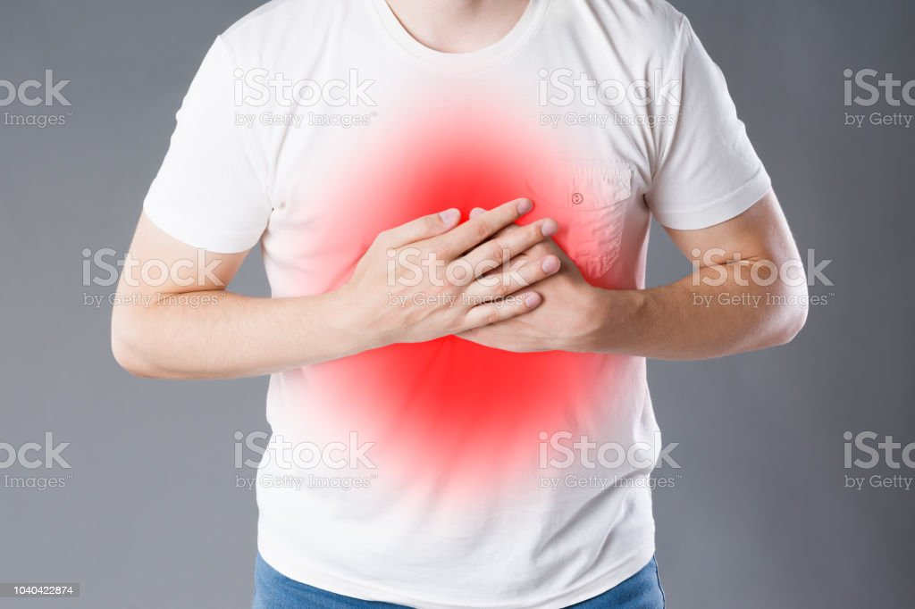 Heart Attack Man With Chest Pain On Gray Background Stock