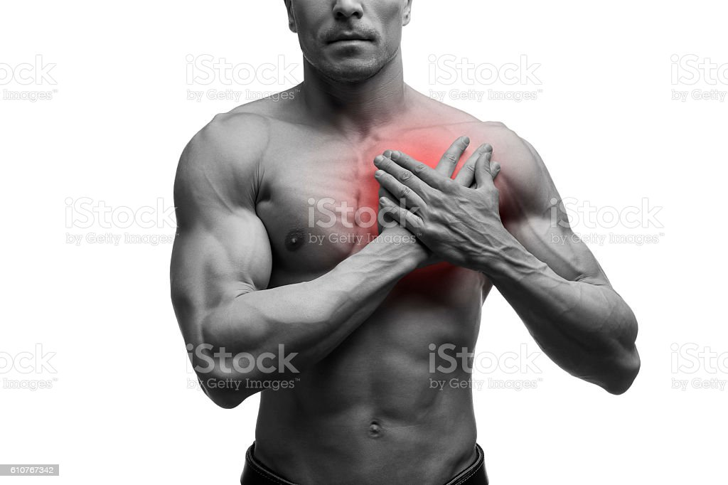 Heart attack, middle aged muscular man with chest pain isolated stock photo