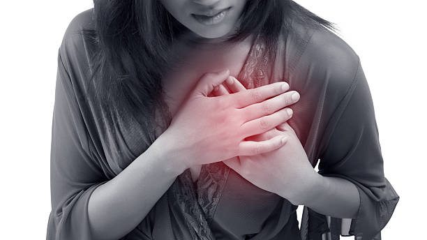 Heart attack Woman is clutching her chest, acute pain possible heart attack acute angle stock pictures, royalty-free photos & images