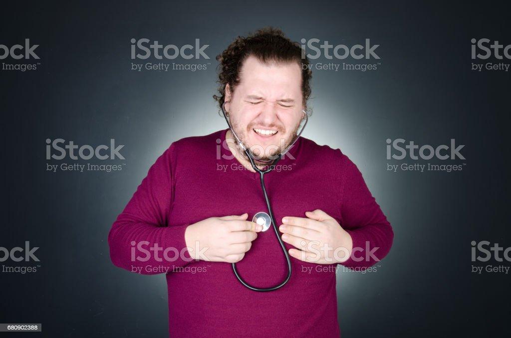 Ataque al corazón. El chico con sobrepeso. - foto de stock