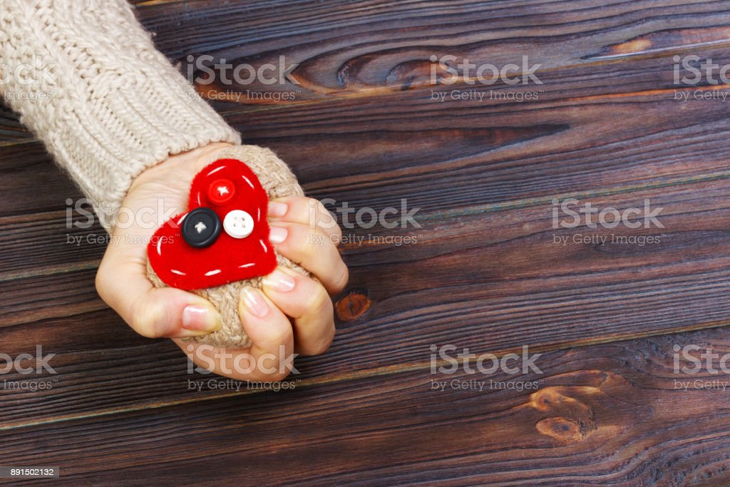Heart Attack with both Hands on wooden background. Love concept with copyspace stock photo