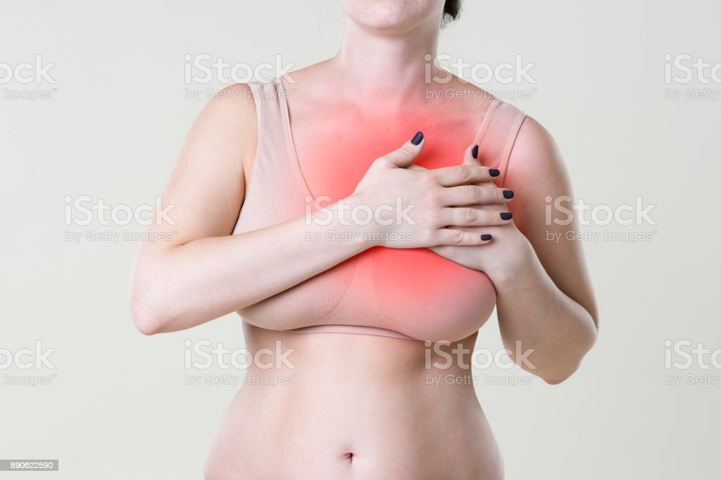 Heart attack, woman with chest pain on beige background stock photo