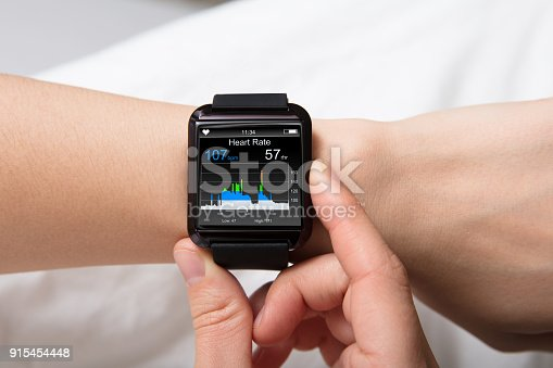Smart Watch Showing Heartbeat Monitor On Woman's Hand
