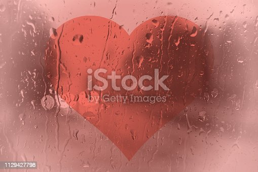 istock Heart behind a pane of glass - in trend color 2019 Living coral 1129427798
