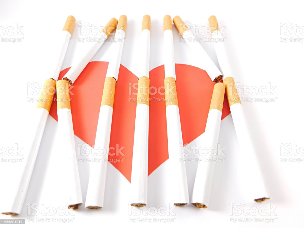 Heart behind cigarette bars. royalty-free stock photo