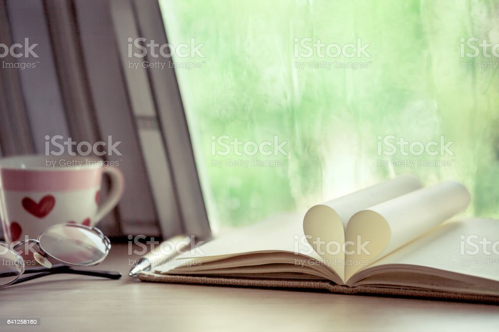 Heart book page on  rainy day window background