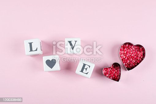 157527860 istock photo Heart Candy and Cubes Word Love. Valentine's Day Concept. Flat lay, top view, copy space 1200338493