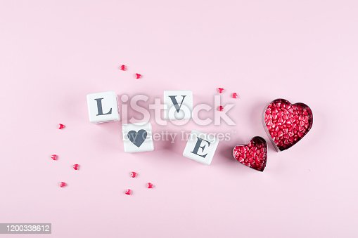 157527860 istock photo Heart Candy and Cubes Word Love. Valentine's Day Concept. Flat lay, top view, copy space 1200338612