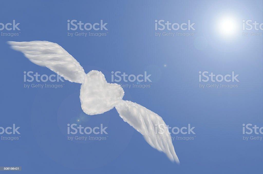 heart cloud shape with wing on blue sky ,freedom heart