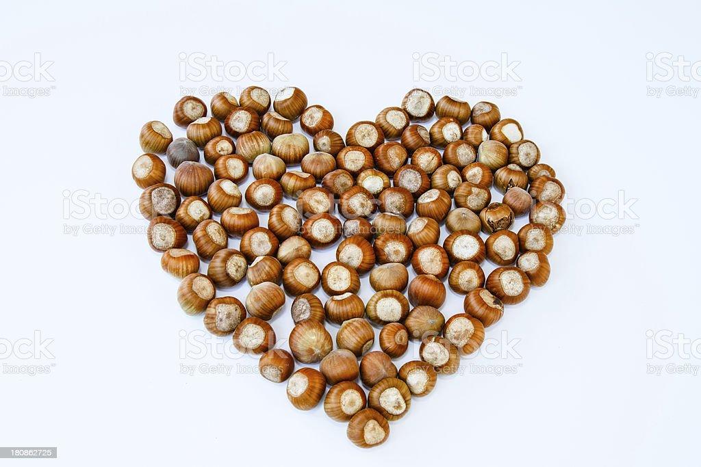 Heart consists of hazelnuts isolated royalty-free stock photo
