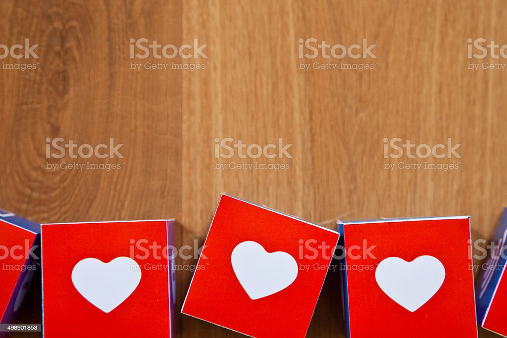 Heart cubes on wooden background royalty-free stock photo
