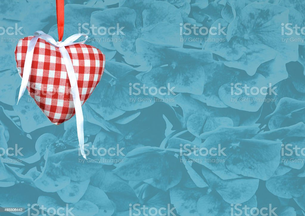 heart decoration against flower texture background stock photo