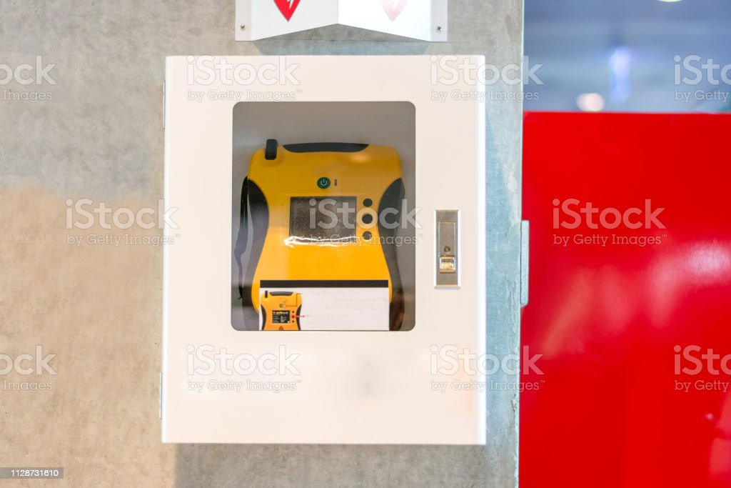 AED Heart defibrillator on a wall in public location stock photo