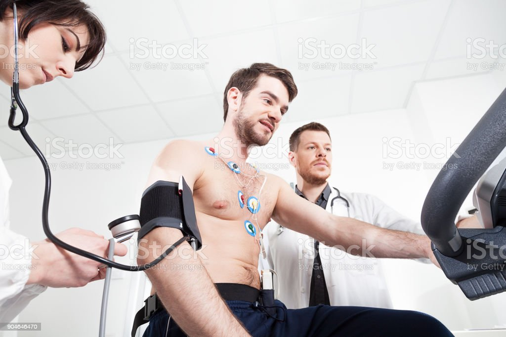 Heart diagnostic test with doctor stock photo