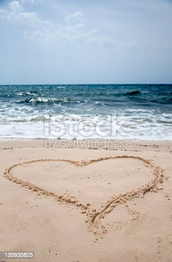 istock Heart drawn in sand 135935825