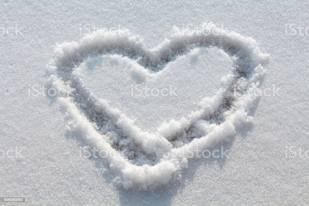 Heart drawn in snow stock photo