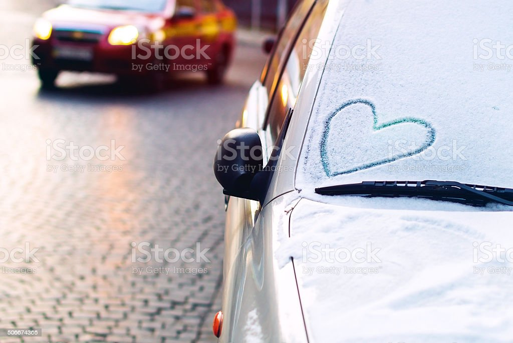 Heart drawn on a car windscreen stock photo