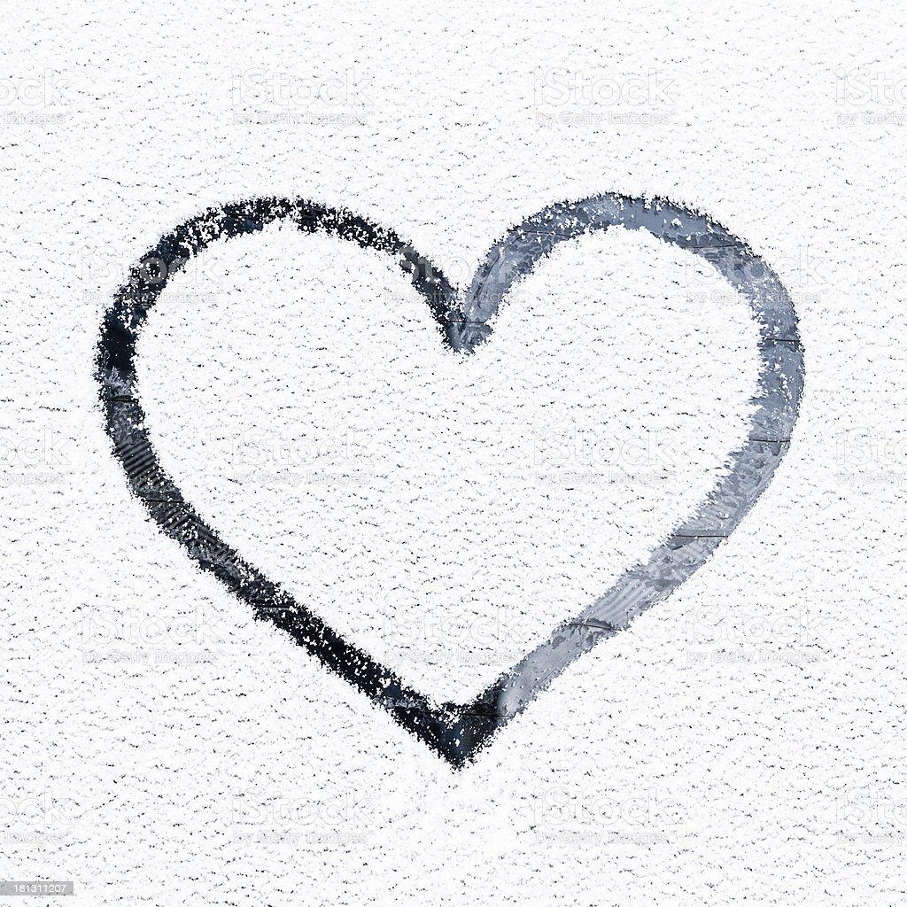 Heart drawn on frosty window. royalty-free stock photo