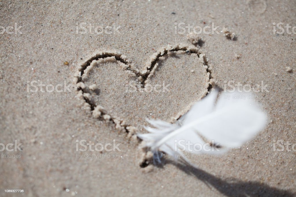 heart drawn on the sand, on the beach. heart drawn with a pen stock photo