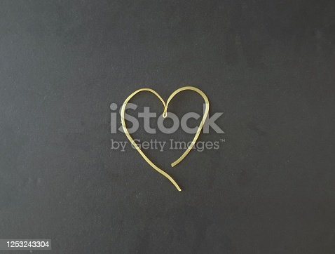 Horizontal color image with black background Copy space. No people. Useful for subjects related to love, cooking, loving each other, recipes, messages from the heart.