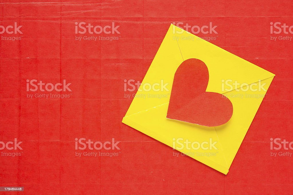 Heart envelope paper on red background royalty-free stock photo