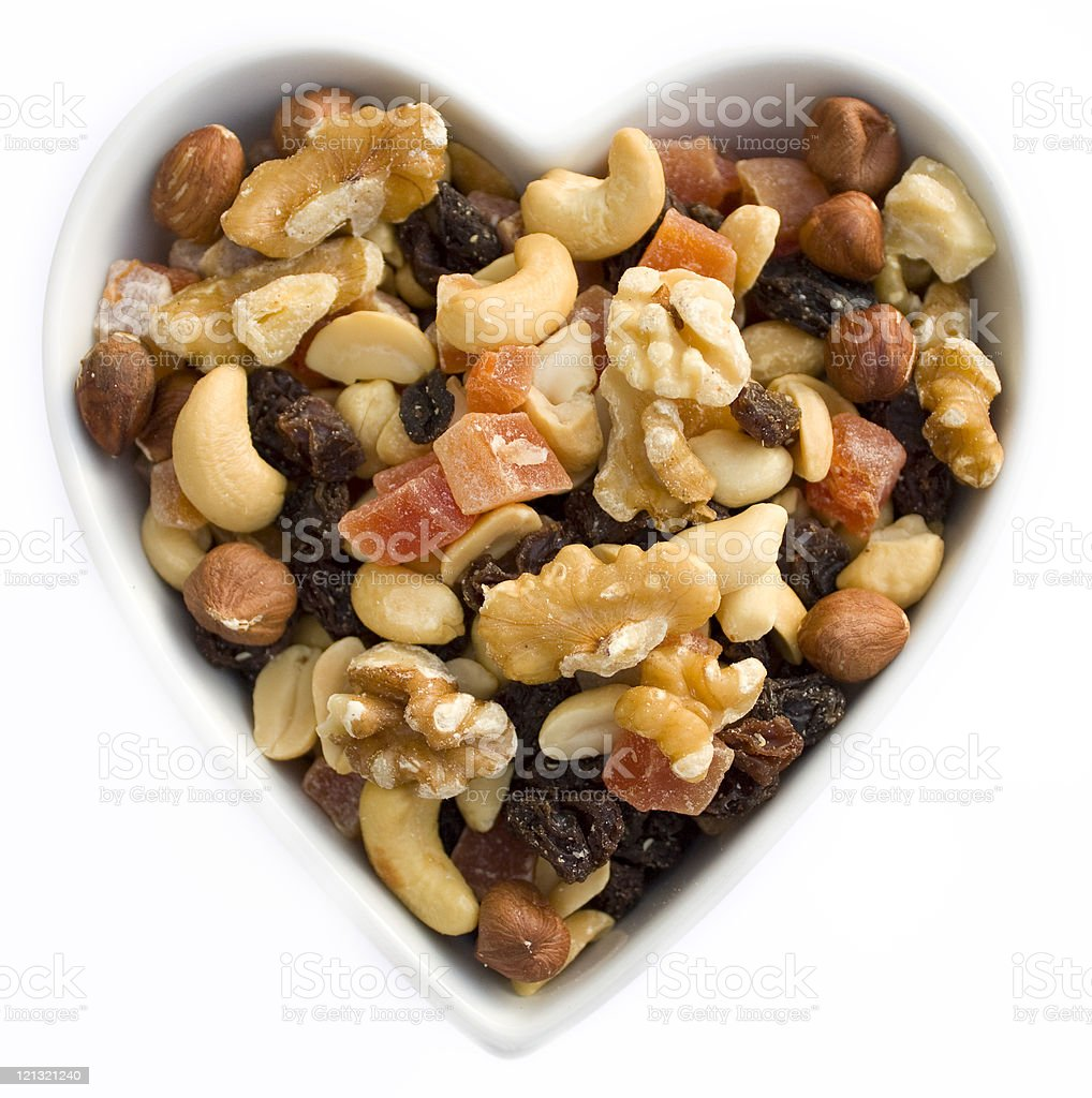 Heart filled with dried fruits and nuts stock photo