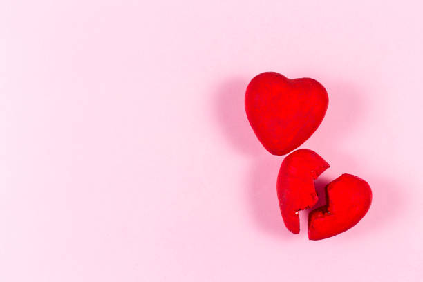 heart from hand made on the pink background.concept of love. - focus on background stock photos and pictures