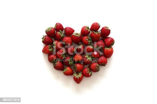 104822052istockphoto A heart from strawberry on the white background. 680001826