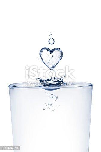 A splash of water shaped like a heart.