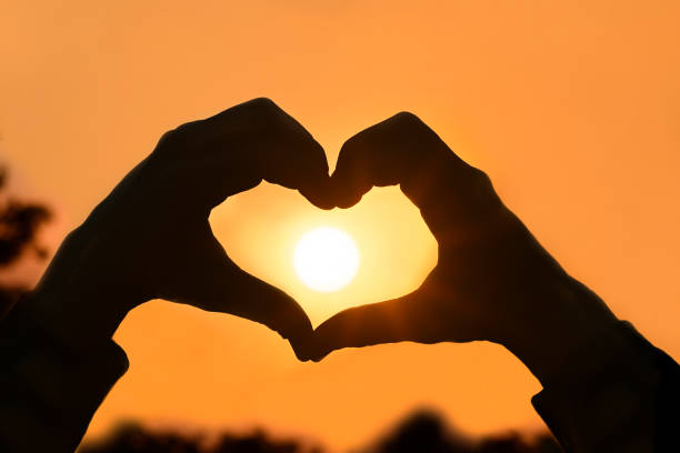 Heart Hands as Sunset silhouette of hands in the shape of a heart at sunset jude beck stock pictures, royalty-free photos & images