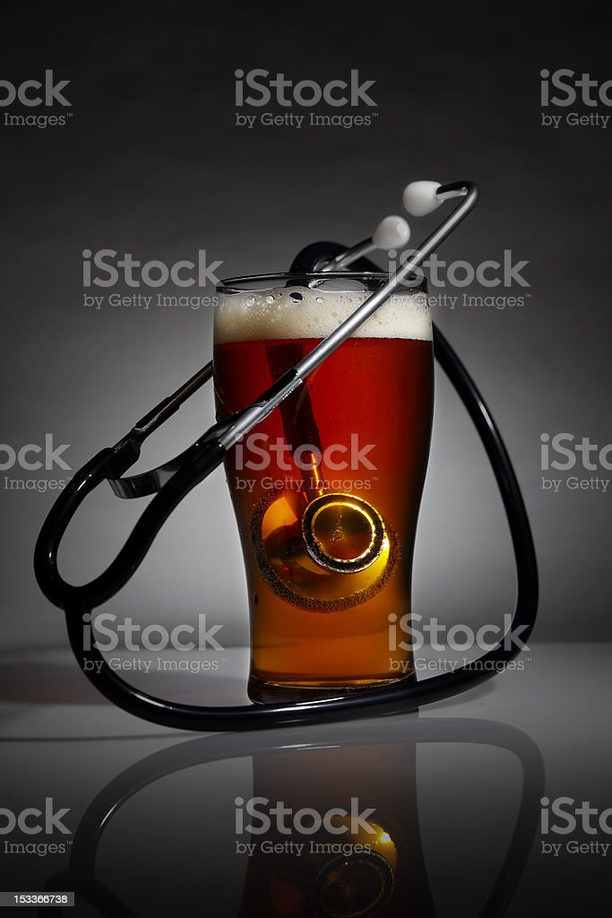 Heart health and beer royalty-free stock photo