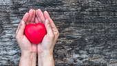 istock Heart health care medical cardiovascular disease concept and organ donor donation for life giving charity campaign with healthy red love heart on aging woman hand support 1080228932