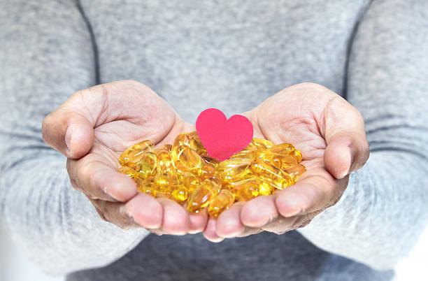 Heart healthy supplement pills stock photo