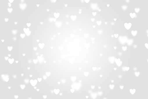 Heart icon bokeh on grey color background.